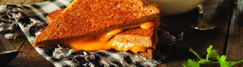 Grilled cheese on a wooden table