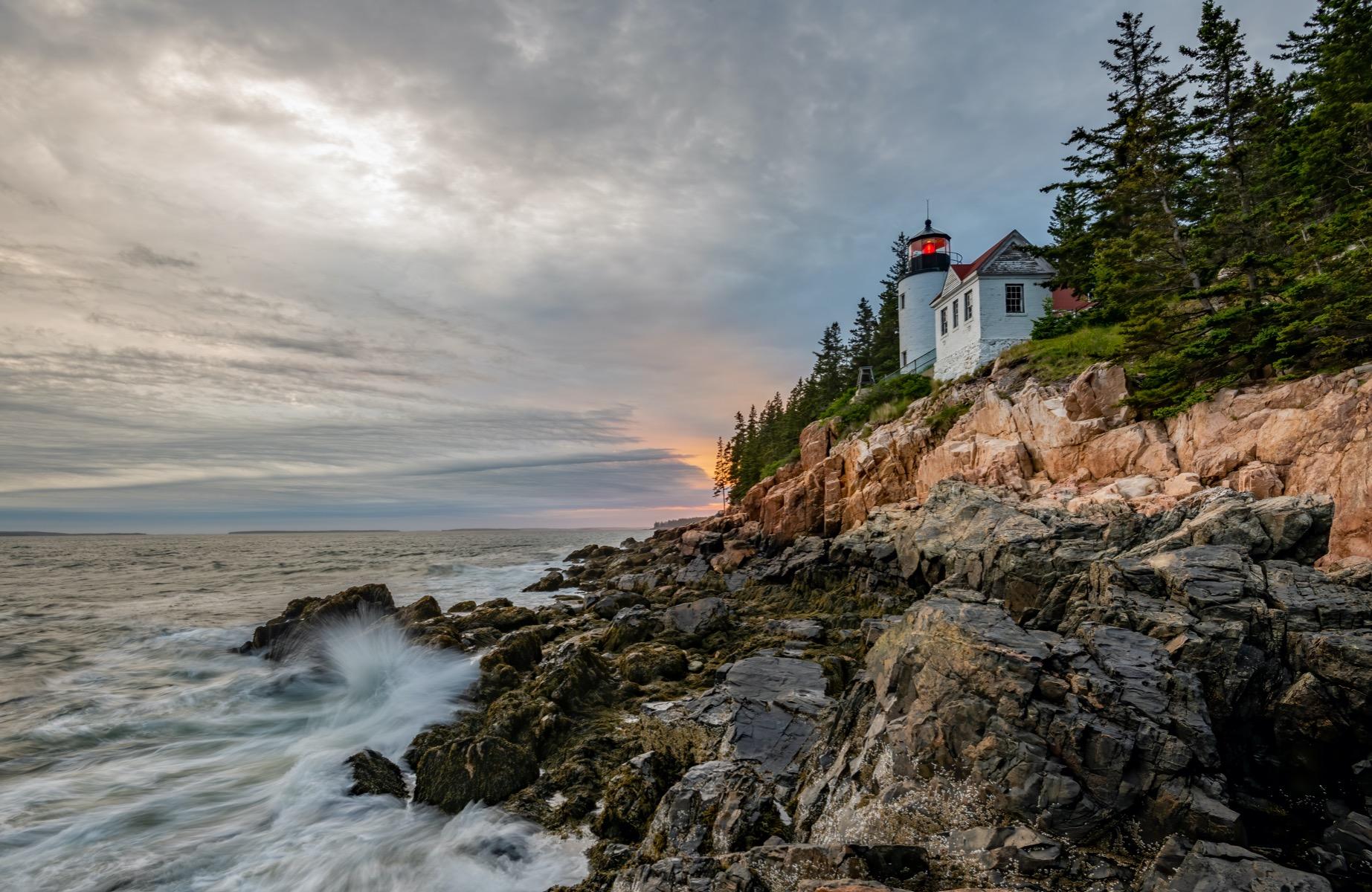 White lighthouse along the rocks