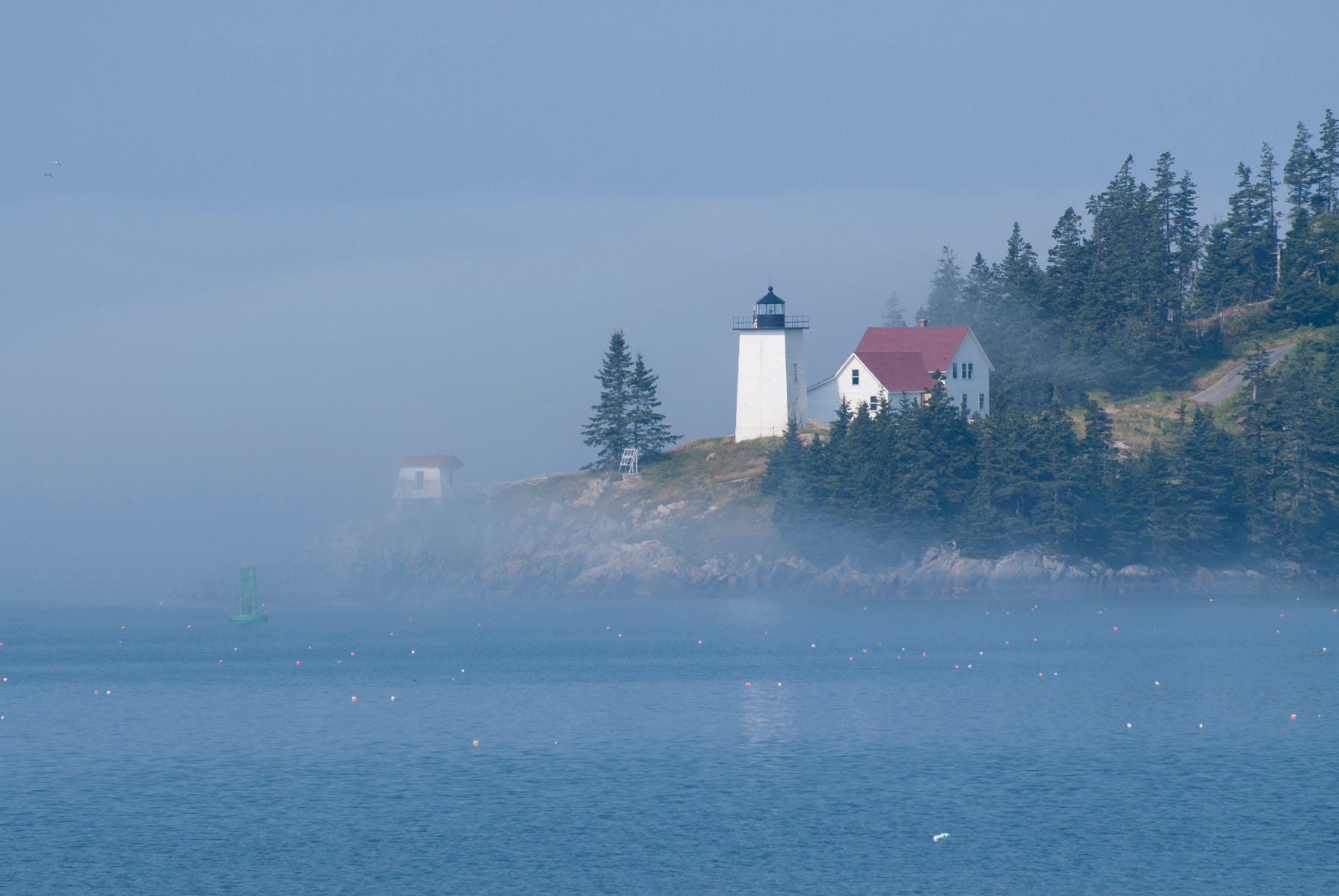 White lighthouse along the water