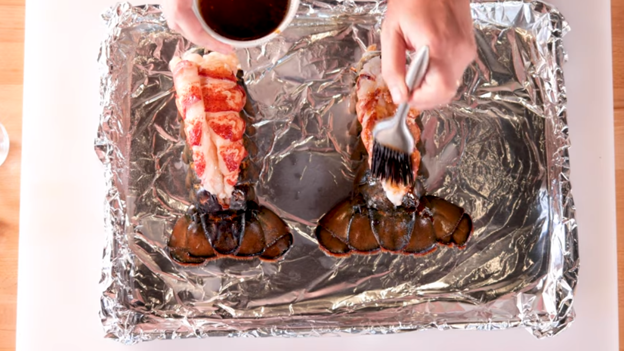 Putting sauce on a lobster tail
