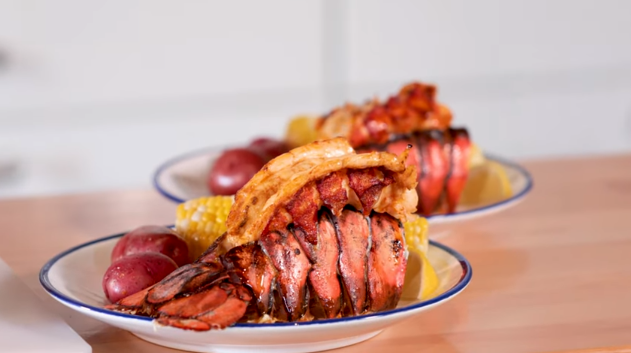 Lobster on a plate with corn and potatoes