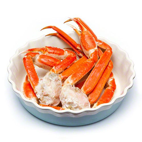 Crab legs in a blue and white bowl