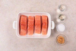 Salmon filets in a white dish