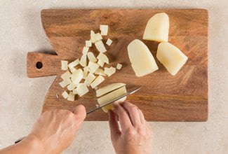 Cutting potatoes on a cutting board