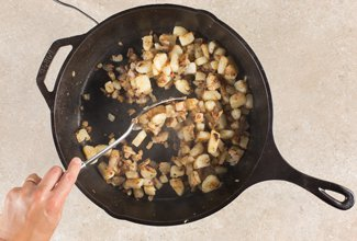 Cooking up potatoes and onions in a cast iron pan